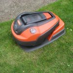 flymo robotic lawnmower resting on lawn