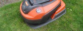 flymo robotic lawnmower resting on lawn